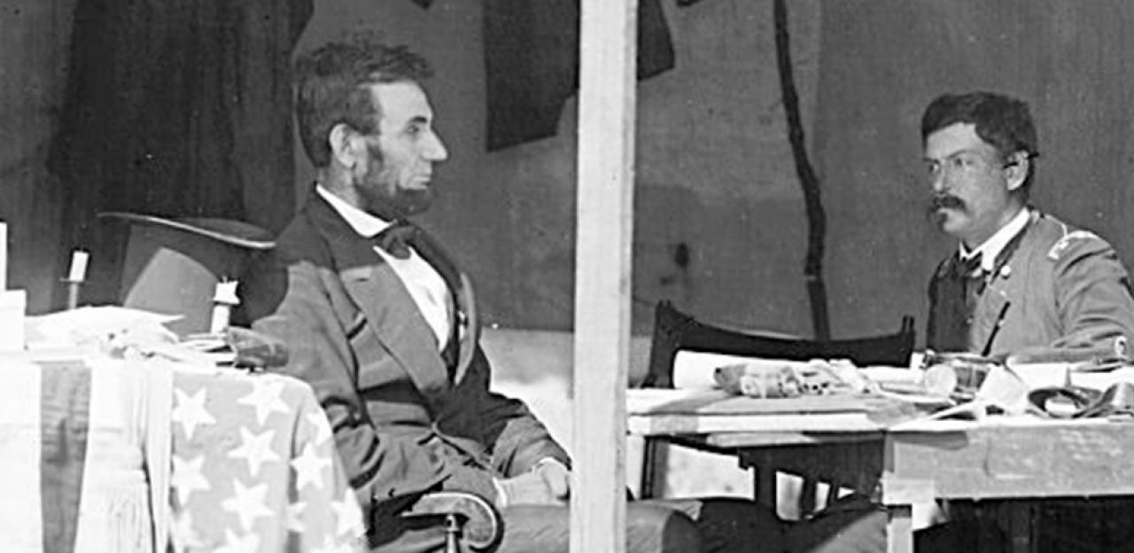 This image depicts Abraham Lincoln sitting and pondering with George McLellan.