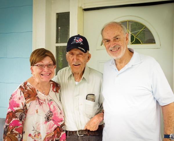 Ed Bearss standing between Dru & Bill Vodra outside his front door
