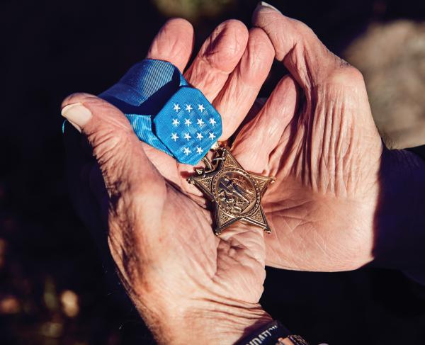MOH Recipient Woody Williams Holds Medal