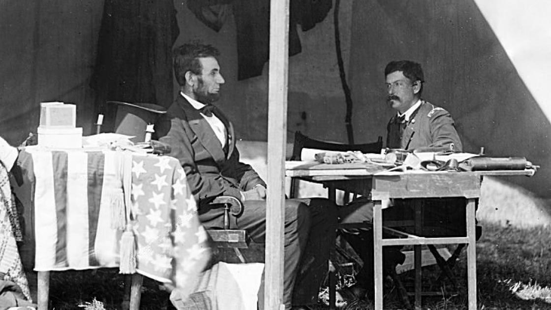 This is an image of Lincoln sitting with McClellan.