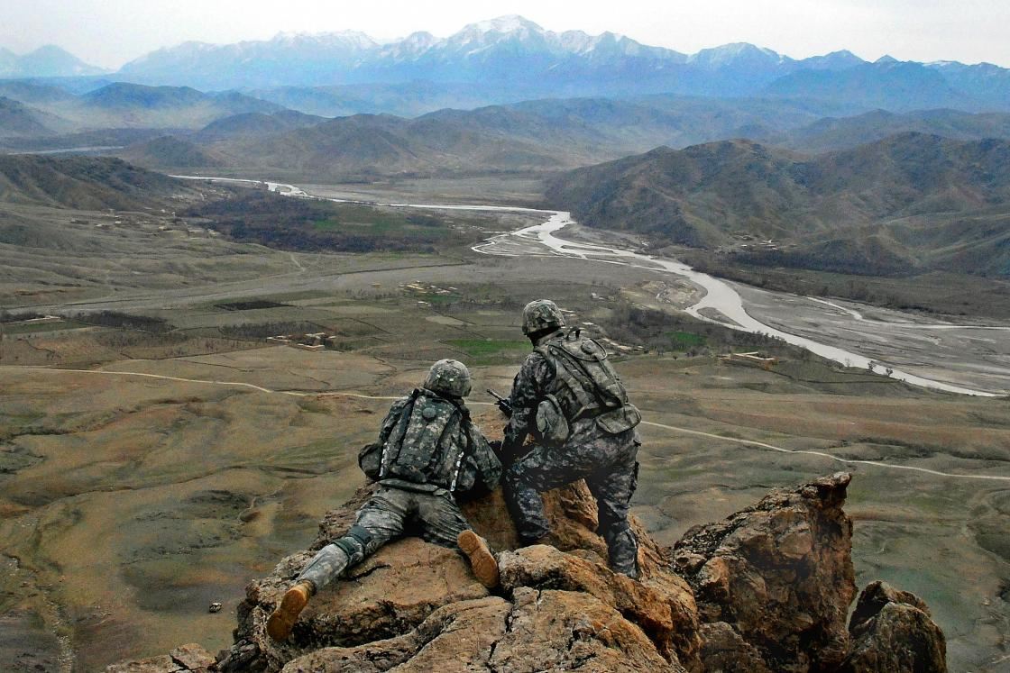 2 4th Infantry officers examine terrain Afghanistan valley