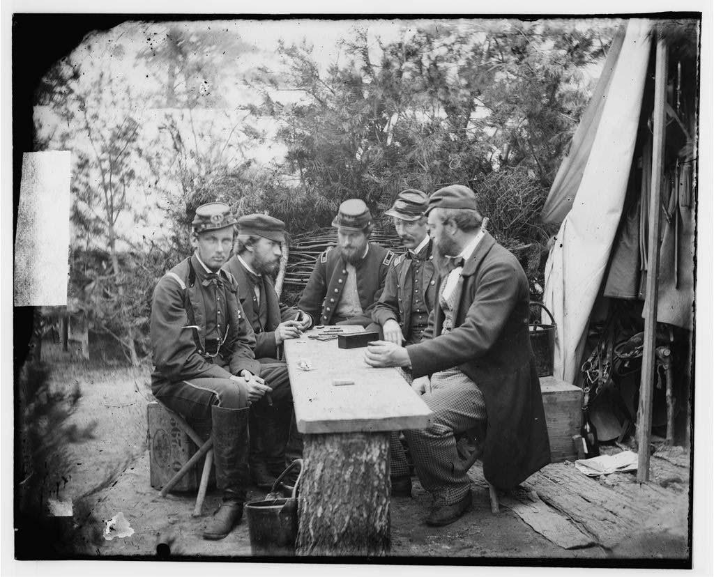Yorktown, Va., vicinity. Duc de Chartres, Comte de Paris, Prince de Joinville, and friends playing dominoes at a mess table, Camp Winfield Scott