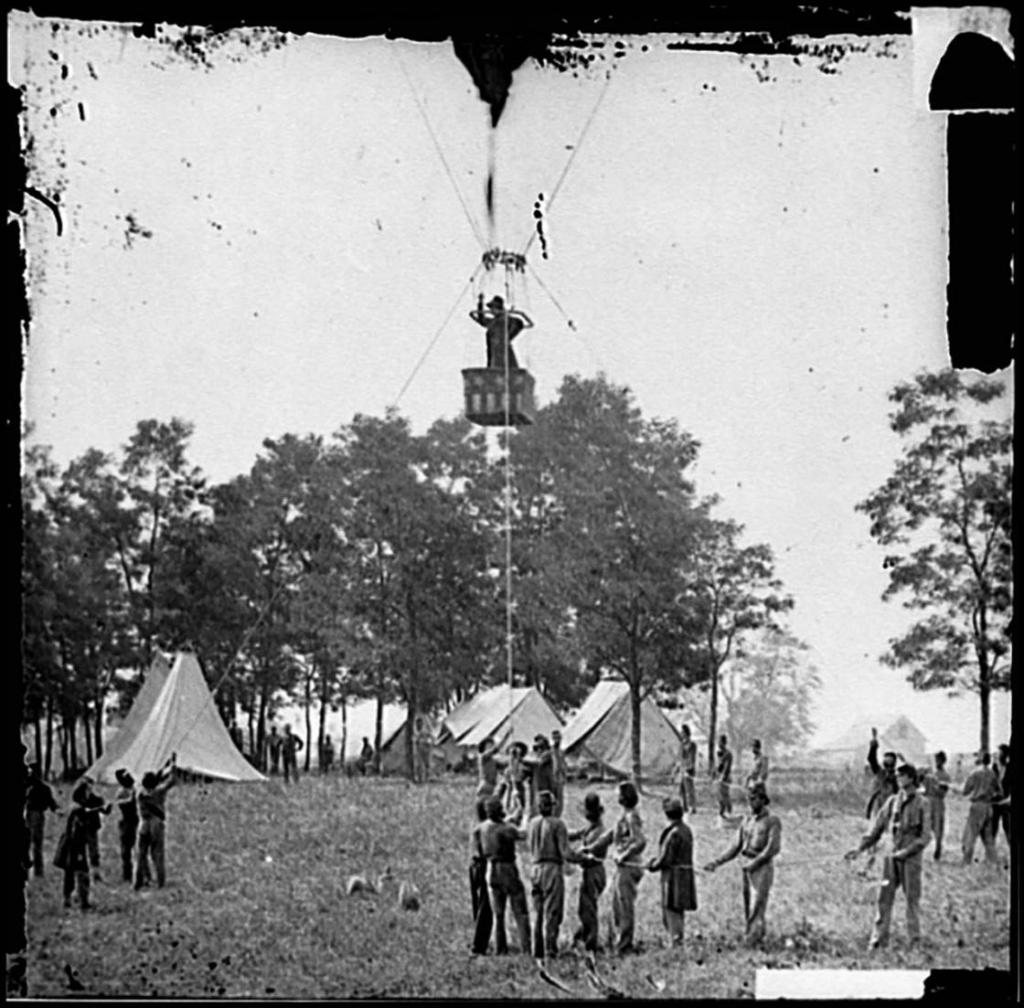 "Fair Oaks, Virginia. Prof. Thaddeus S. Lowe observing the battle from his balloon ""Intrepid"""