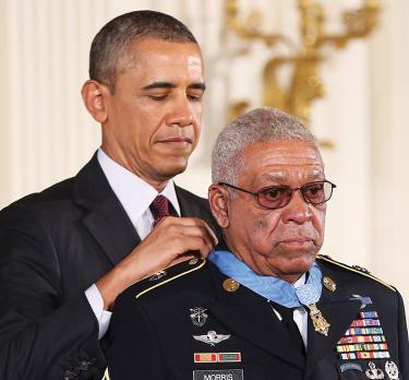 Morris_Melvin_USDeptOfVeteransAffairs_ObamaPuttingOnMedal_HRsmaller.jpg